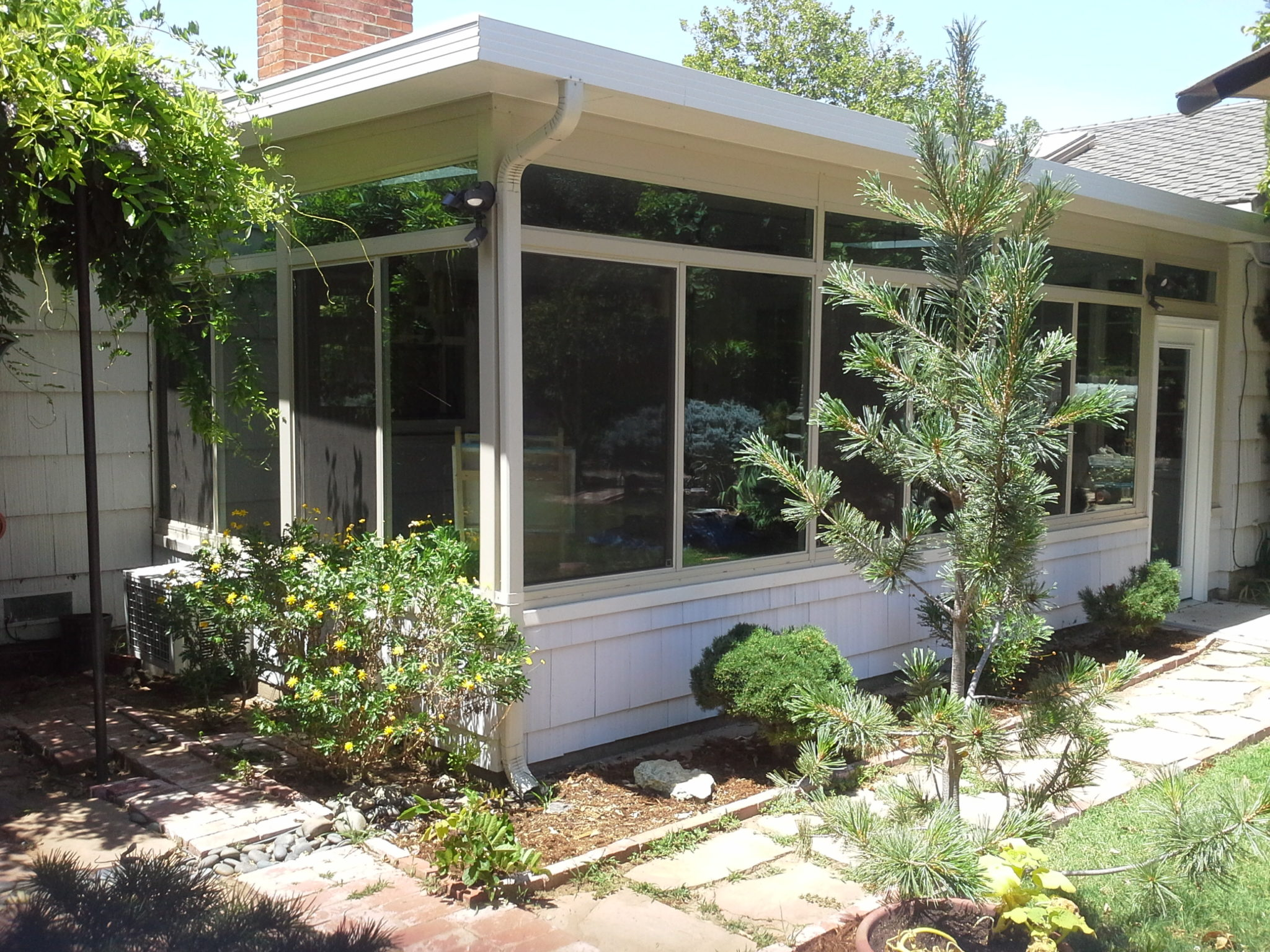 Sunroom living area addition petkus brothers for Two story sunroom additions